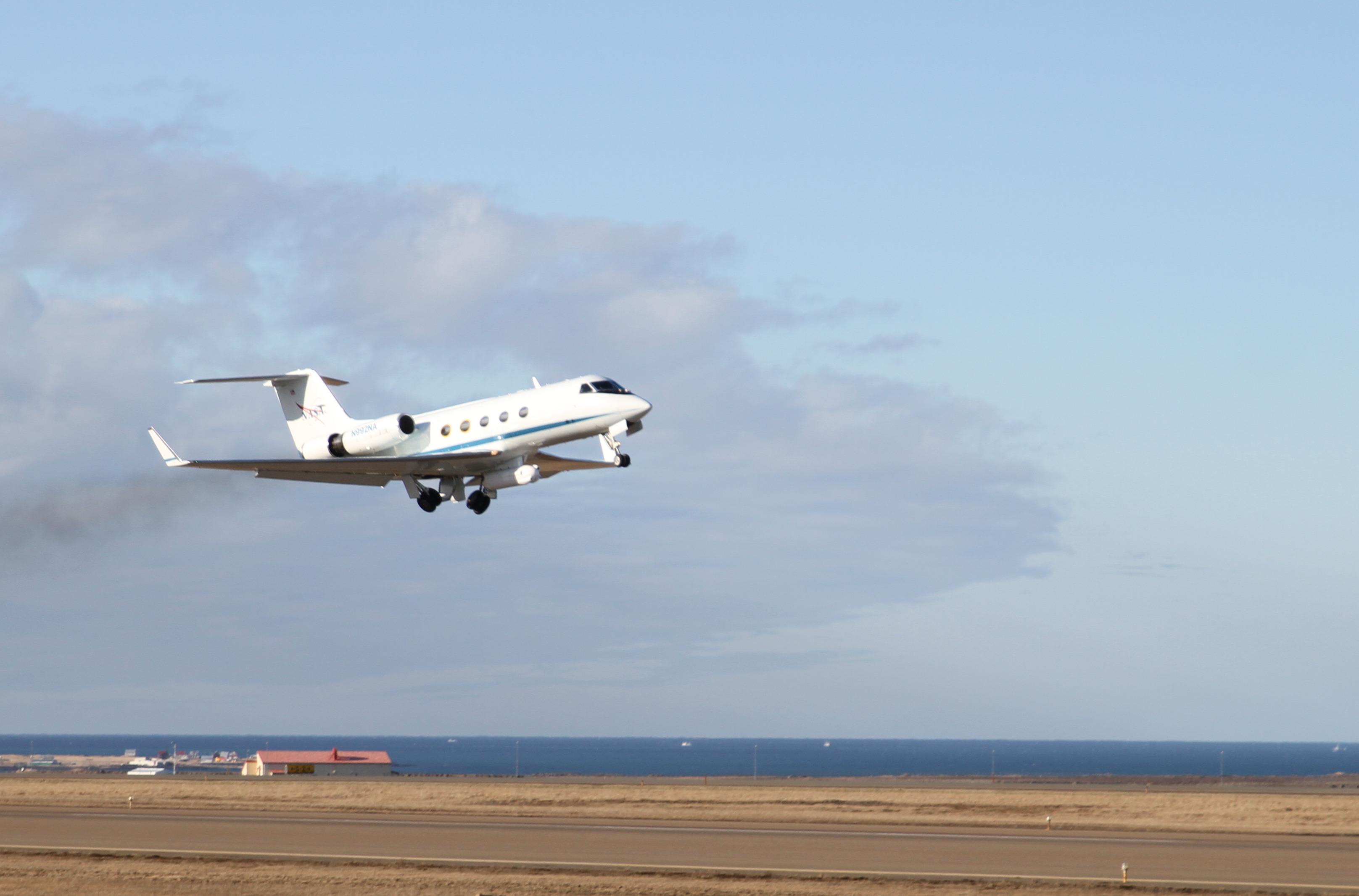 Image of NASA G-III taking off from Iceland.