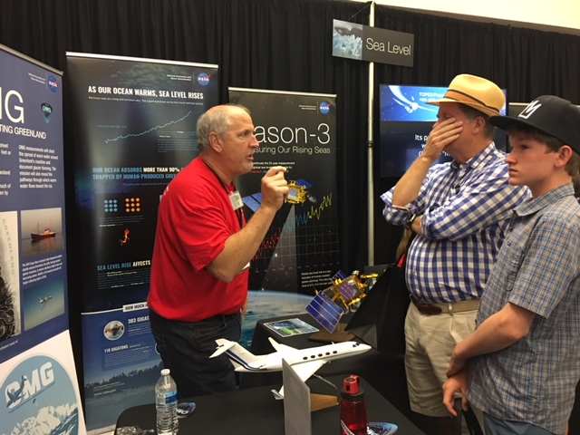 Steve Dinardo, OMG Project Manager, discussing OMG project goals with members of the public at the JPL Open House in June 2018.