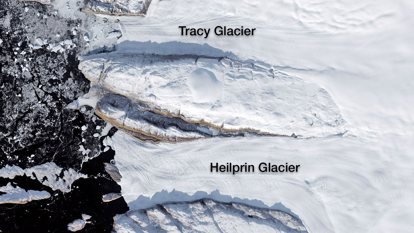 Tracy and Heilprin glaciers in northwest Greenland. The two glaciers flow into a fjord that appears black in this image.